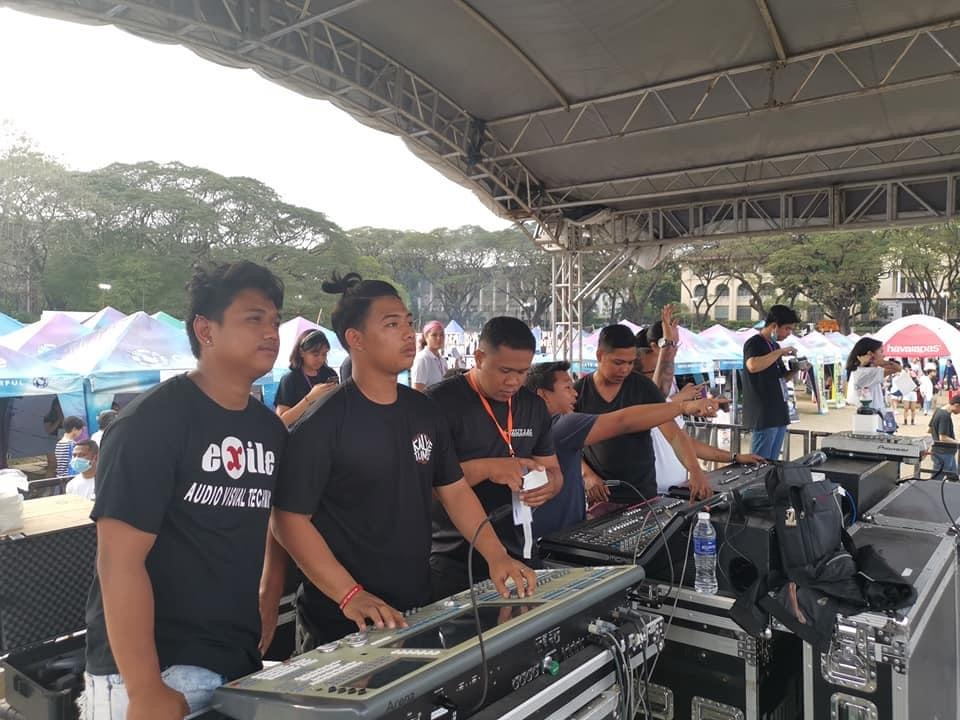 Exile's professional technicians for 2020 UP Diliman Fair with mixing console for lights, sound system and LED Wall under a roofing with trusses